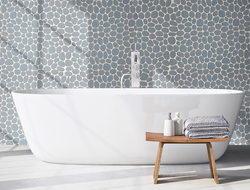 Island Stone launched the Spindrift interlocking tiles, which combine the comfort of a flat, matte mosaic with the shapes and organic style of stone pebbles.