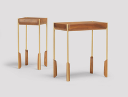 The Altai side table has legs made of metal and carved timber.