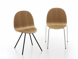 The Etabeta chair has a narrow seat and a large backrest to provide both comfort and form to its users.