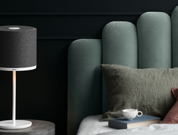 The Capella table lamp has a specially designed base that appears lightweight.