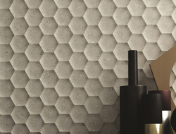 The collection includes coordinated wall and floor tiles, offering a complete design solution.