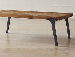 Crate & Barrel launched the Lakin recycled teak coffee table, which combines a recycled wood top with metal legs.