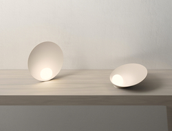 Musa is available as either a wall sconce or table lamp.