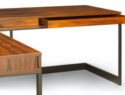 The customizable desk features a large-scale 'L' shape, incorporating the Wishbone aesthetic of daring cantilever and streamlined proportions.