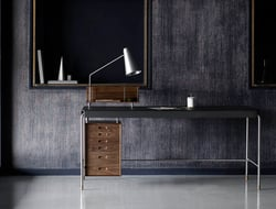 Danish furniture company Carl Hansen & Son announced the Society table, which combines steel, veneer, leather and wood.