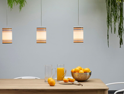 The May pendant is hand-painted in-house with clean, straight lines of varying widths.