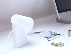 It is made of single cast metal, with the desk lamp available in one of three colors.