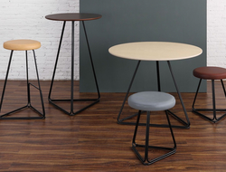 m.a.d. furniture design launched the Delta collection of tables and stools with a delta-shaped based.