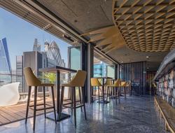 Dexter Moren Associates influenced by Asian-inspired modern design for Jin Bow Law Skybar in Dorsett City Hotel.
