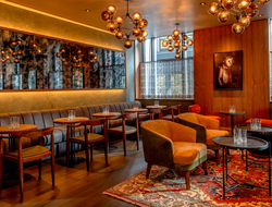 Punch Architecture renovates Kimpton Nine Zero's Highball Lounge.