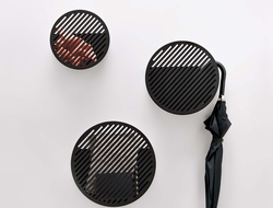 Each lacquered-steel basket comes in three sizes and is available in a variety of colors to suit any interior.
