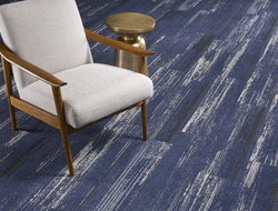 The solution-dyed carpet tiles are made with a type 6 nylon fiber—manufactured by Bristol, Va.–based Universal Fibers—which tops a PVC-free, open-cell, cushion backing.