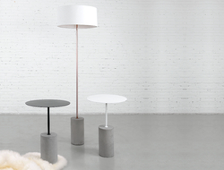 The Pier occasional table has an industrial-inspired cast concrete cylinder base that fuses with a round table top.