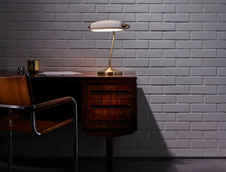 Bankers is a contemporary light that sits well on grand mahogany desks and clean-lined work spaces.