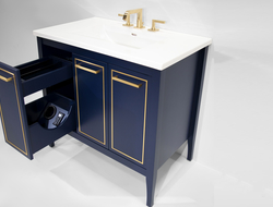 Three long drawer fronts are outlined with a decorative metallic trim that compliments the horizontal pull handles.