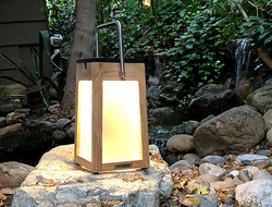 Made in a warm teak finish, this outdoor lantern features clean lines, a pivoting handle and a slightly tapered base for balance.