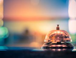 Bell at hotel desk