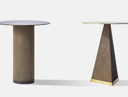 The side tables are offered in a cylindrical or triangular solid brass or cold-rolled steel base that's cloaked in metal mesh.