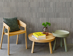 Ribsy wallcovering has a deep ribbed texture created with thick wool felt strips oriented on edge in alternating heights.