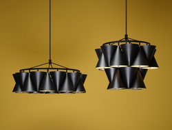 Conical in shape, each lamp is anchored on a rigid aluminum structure comprised of multiple tiers, allowing for a variety of designs once each of the individual modules is added.