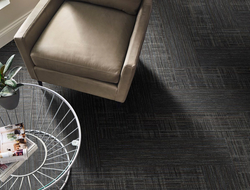 Tarkett launched Resonate + Capture, a soft surface collection that features QuickShip Modular tiles.