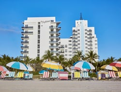 Exterior of The Confidante Miami Beach from the beach