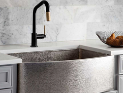 The sink is hand-crafted out of recycled materials, made from durable, 16-gauge copper.