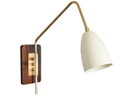 Blending Scandinavian, Danish and Italian modernism, Elska takes form against a walnut back plate with distinct, brass fittings.