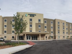 Front exterior of WoodSpring Suites Orlando International Drive