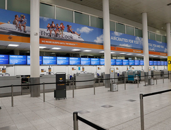 Empty Thomas Cook check-in desk in Gatwick Airport, England