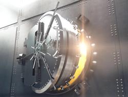 Open bank vault door and gold light