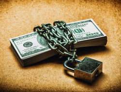Lock and chain securing stack of cash