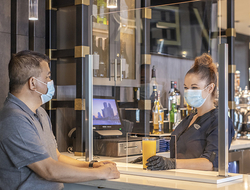 man at a bar with a mask at Hyatt Regency Jacksonville