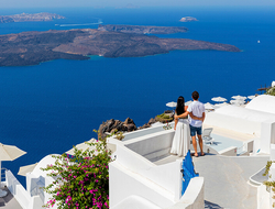 couple in Greece overlooking ocean