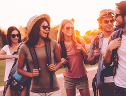Group of young men and women traveling