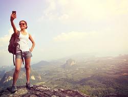 female hiker taking a selfie