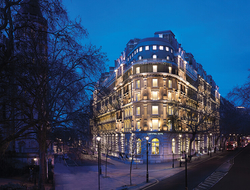 Corinthia Hotel London facade at night