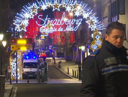 In this image made from video, emergency services arrive on the scene of a Christmas market in Strasbourg, France.