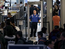 Transportation Security Administration agents help passengers through a security checkpoint at Newark Liberty International Airport