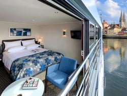 An open Avalon Waterways panorama suite with a town visible in the background
