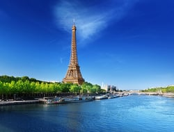 The Seine River flowing by the Eiffel Tower in Paris