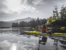 A woman kayaks in Great Bear Rainforest