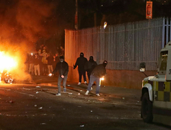 Petrol bombs are thrown at police in the Creggan area of Londonderry, in Northern Ireland.