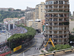Image of people watching the race from a tower