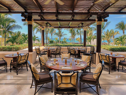 outdoor room with tables and chairs