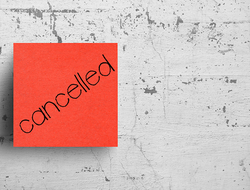 Cancelled written on sticky note