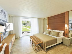 The rooms at the revamped Canonnier Golf Resort & Spa now use linen, rattan, wood and raffia to echo the vegetation and gardens of the resort's grounds.