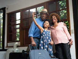 Grandparents and Granddaughter taking selfie in a hotel