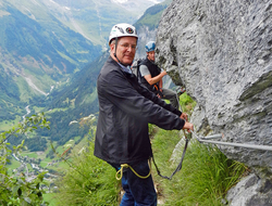 Rick Steves traversing the via ferrata