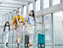 Family wearing masks at the airport